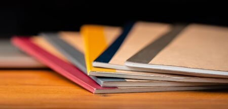 Close Up of Several Notebooks with Unfocused Background. Zdjęcie Seryjne