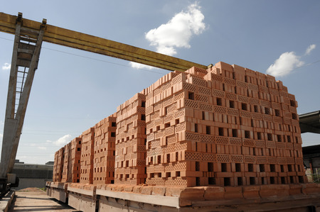 loading bricks from the factory into transport 스톡 콘텐츠