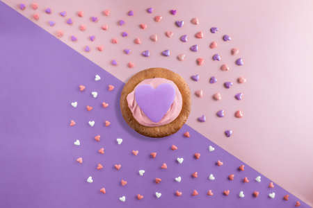 beautiful flat lay pattern of hearts with cupcakes with cream and a serenity heart on a serenity and rose quartz background
