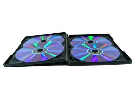 Four CD-ROM in a black box with a rainbow of reflections