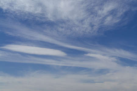 spindrift clouds in the blue sky  Stock Photo