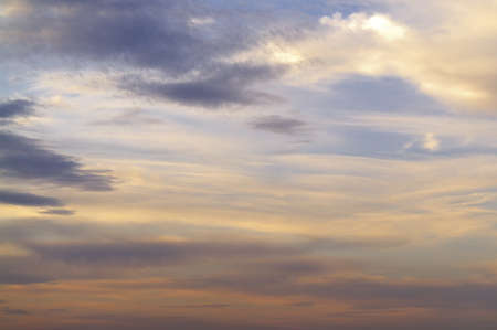 cirrus clouds on the background of sunset sky