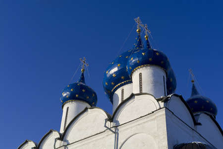 Domes of the Nativity Cathedral in Suzdal Kremlin, frosty sunny day  Stock Photo