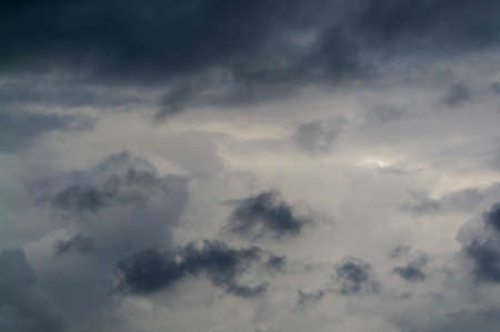 Gray sky with dark torn clouds. Stock Photo
