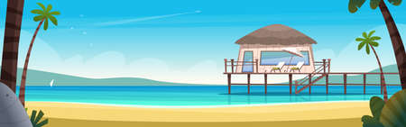 Hotel bungalow on a blue clear and calm sea. Summer vacation concept. Private house on a secluded sea beach with pier
