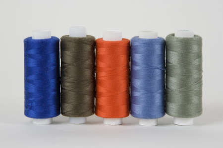 Coils with threads for sewing machines, fashion Stock Photo - 9115100