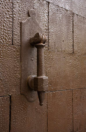 The door pen on old doors of a fortress. photo