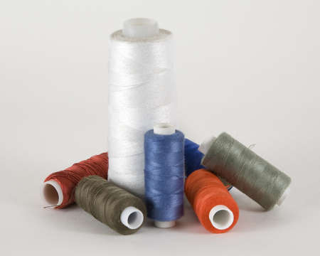 Coils with threads for sewing machines, fashion. Stock Photo - 9224180