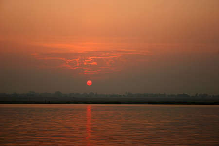 Sunrise on the river Ganges, a landscape, a city of Varanasi, India. Stock Photo - 9219174