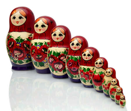 Nested doll - a Old national Russian doll of handwork. Stock Photo