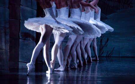 Feet of ballerinas during dance execution, body performance choreography photo