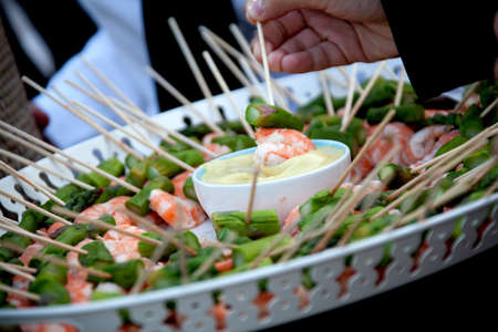 Professional catering service serving appetizer to guests