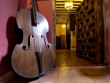 jazz time: Contrabass in an interior in rural style  Stock Photo