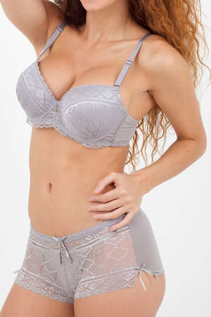 Beautiful woman standing dressed only in underwear photo
