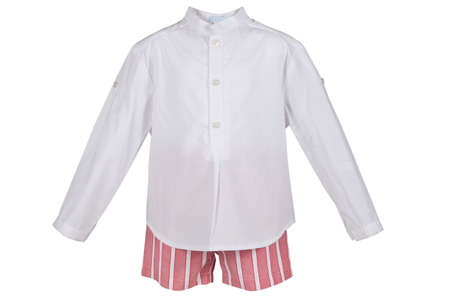 Childrens set of clothes from a shirt and a shorts isolated on a white background. photo