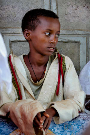 amharic: TURMI, ETHIOPIA - NOVEMBER 22, 2011: Portrait of the boy helping the priest in the Ethiopian orthodox church. November 22, 2011 in Turmi, Ethiopia. Editorial