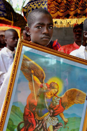 TURMI, ETHIOPIA - NOVEMBER 22, 2011: Portrait of the boy helping the priest in the Ethiopian orthodox church. November 22, 2011 in Turmi, Ethiopia. Editorial