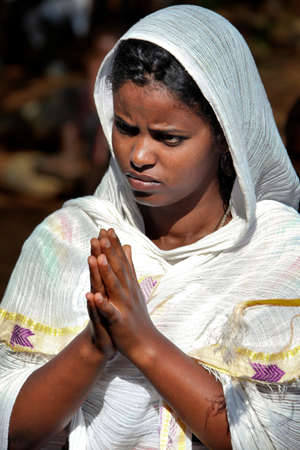 TURMI, ETHIOPIA - NOVEMBER 22, 2011: The woman prays during celebration in orthodox church. November 22, 2011 in Turmi, Ethiopia.