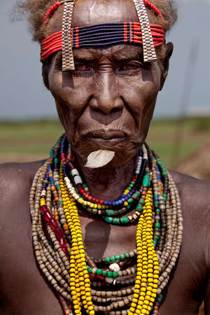 rift: SOUTH OMO - ETHIOPIA - NOVEMBER 23, 2011: Portrait of the unidentified old woman from the African tribe Dasanech, in November 23, 2011 in Omo Rift Valley, Ethiopia.