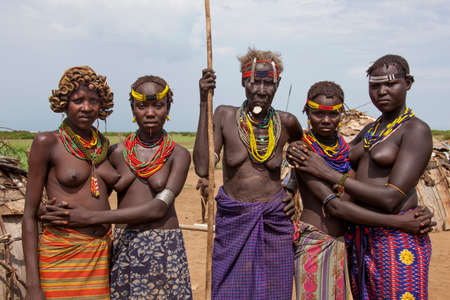 SOUTH OMO - ETHIOPIA - NOVEMBER 23, 2011: Group portrait of the unidentified womans from the African tribe Dasanech, in November 23, 2011 in Omo Rift Valley, Ethiopia. Editorial