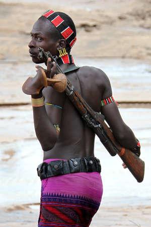 ethnology: SOUTH OMO - ETHIOPIA - NOVEMBER 21, 2011: Unidentified Hamer warrior on November 21, 2011 in South Omo, Ethiopia. Editorial