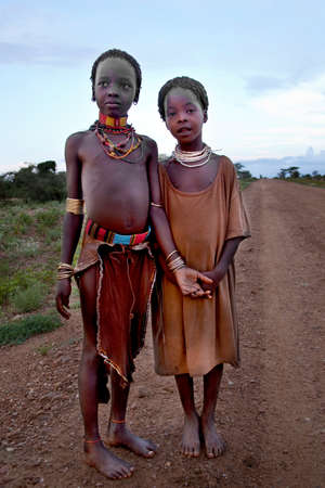 ethnology: SOUTH OMO - ETHIOPIA - November 23, 2011: Unidentified Hamer girls on November 23, 2014 in South Omo, Ethiopia. The girlss portrait from a tribe a hamer, Ethiopia.