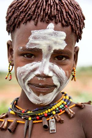 ethnology: SOUTH OMO - ETHIOPIA - November 24, 2011: Unidentified Hamer boy on November 24, 2014 in South Omo, Ethiopia. The boys portrait from a tribe a hamer, Ethiopia.