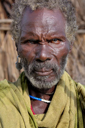 SOUTH OMO - ETHIOPIA - NOVEMBER 25, 2011: Portrait of the unidentified old man from the African tribe Dasanech, in November 25, 2011 in Omo Rift Valley, Ethiopia.