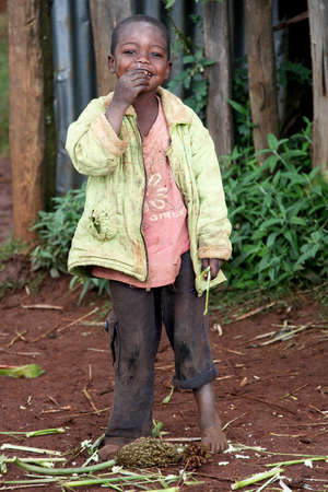 rift: SOUTH OMO - ETHIOPIA - NOVEMBER 26, 2011: Portrait of the unidentified boy from Ethiopia, in November 26, 2011 in Omo Rift Valley, Ethiopia. Editorial