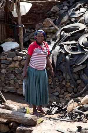 impenetrable: Karat Konso - ETHIOPIA - NOVEMBER 19, 2011: Portrait of the unidentified woman who makes sandals of automobile tires Africa, in November 19, 2011 in Omo Rift Valley, Ethiopia. Editorial