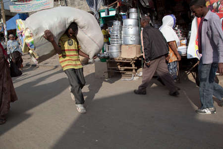 addis: ADDIS ABABA. ETHIOPIA - NOVEMBER 29, 2011: Merkato market workers. Merkato market is the largest open air market in Africa.