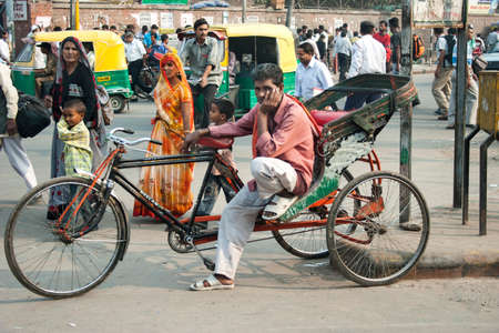 trishaw: DELHI, INDIA - OCTOBER  30, 2006: Unidentified Indian trishaw driver in Delhi, India. Bicycle rickshaw on the street of Delhi. Editorial