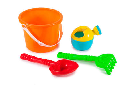 colorful toys for childrens sandboxes against the sea and the beach Stock Photo