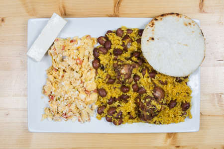 Calentado is a colombian cuisine dish made from reheated leftovers including rice,egg, pasta, beans, potatoes and other foods such as arepa, chorizo, and ground beef.