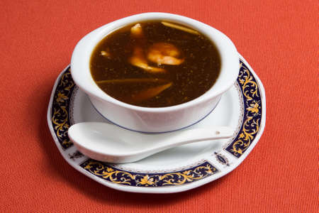 Shark fin soup is a traditional soup or stewed dish found in Chinese cuisine. 免版税图像