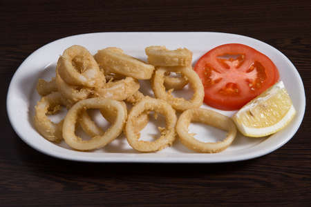 Calamares a la romana spanish dish served with lemon on the side, or as a sandwich.
