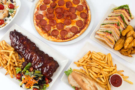 Fast food: top view of ribs, pizza, sandwich, chicken wings, chips Stok Fotoğraf