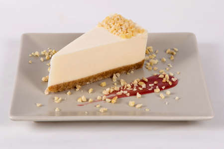 Delicious sweet piece of cheese cakes on a white plate