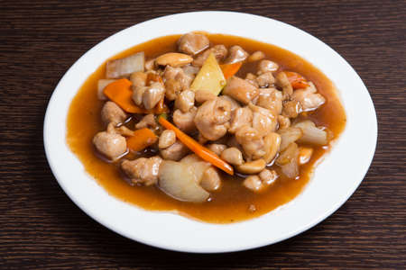 Chicken with almond and oyster sauce. Chinese dish