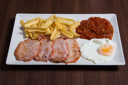 Closeup of a combo platter with fried egg, burger and french fries