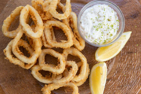 Typical spanish tapas. Fried squid rings ration. (Racion de Calamares fritos)
