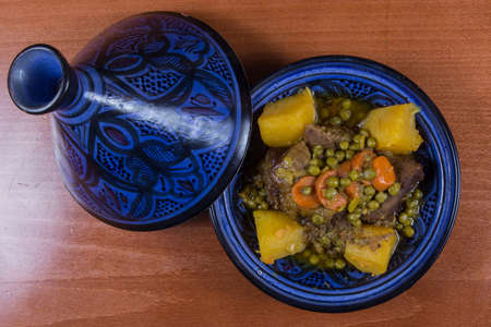 Traditional moroccan tajine of beef with carrots and peas.