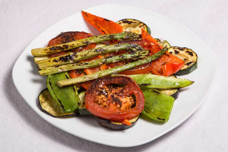 grilled vegetables with slice of tomatos, paper,asparagus, eggplant, delicious vegan meal that frugal, healthy