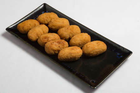 Potato croquettes (croquetas) in a white plate. Fast Food.