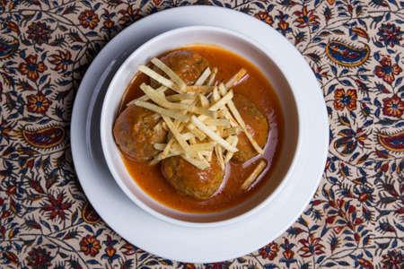 Iranian cuisine Oshe Anor, meatball soup, white plate