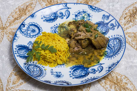 Beef Madras curry slow cook Indian spicy chili butter lamb food with rice. Stock Photo