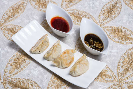 Traditional homemade chicken and vegtables gyozas with oriental soja souce Stock Photo