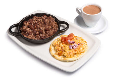 cazuela de frijoles with arepa and cup of coffee on a white background