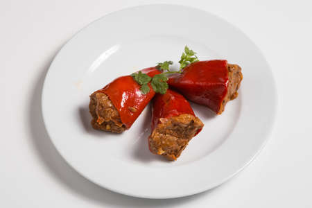 Spanish cuisine. Sweet peppers stuffed with meat. Pimientos del Piquillo rellenos de carne de ternera