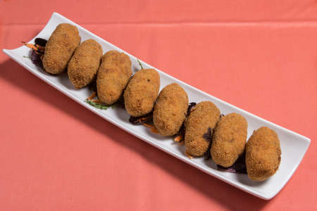 Potato croquettes croquetas in a white plate. Fast Food